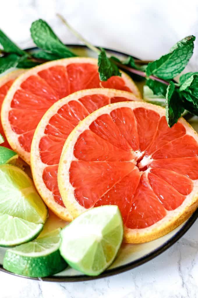 sliced grapefruit and limes