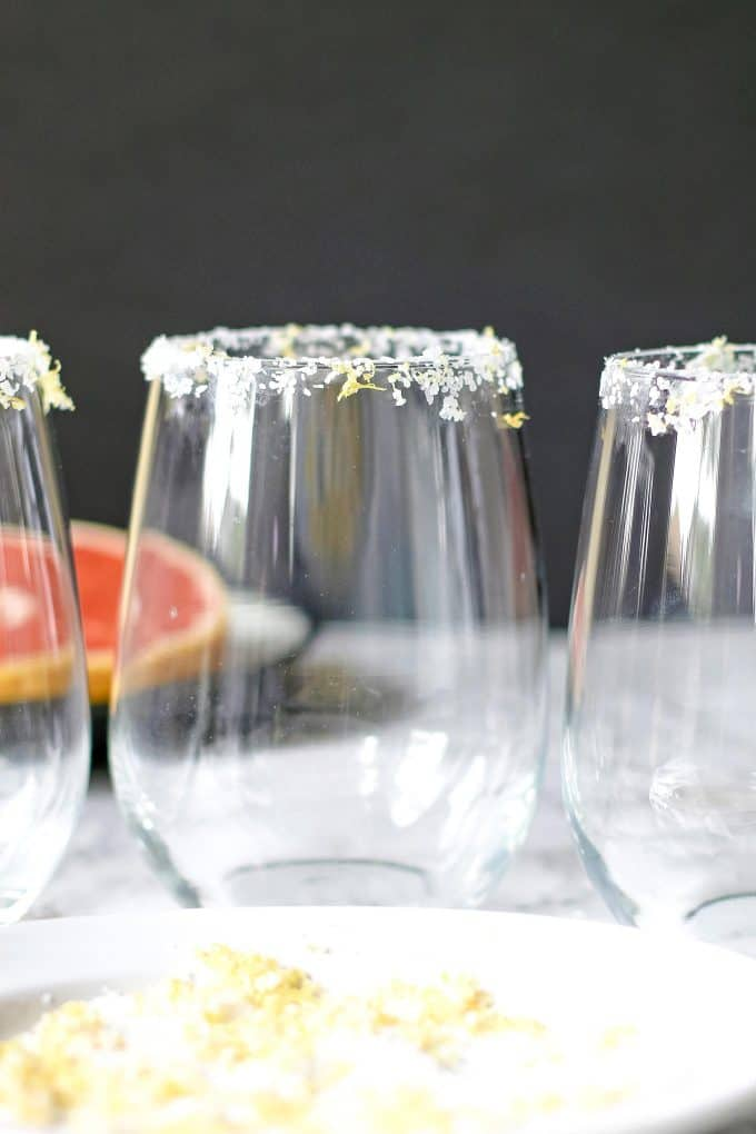 3 glasses rimmed in citrus margarita salt