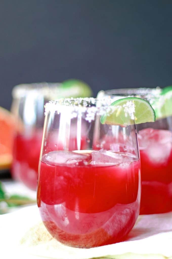 three grapefruit hibiscus margaritas