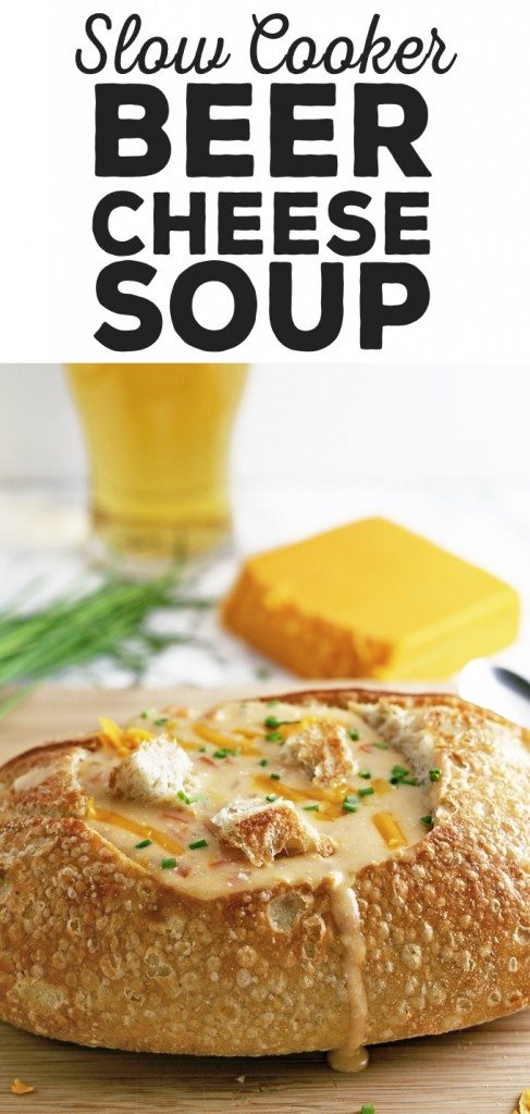 This slow cooker beer cheese soup is super easy to make! It combines sharp cheddar cheese, cream cheese and beer and is delicious for lunch or dinner. Serve it with crusty bread or like me, in a sour dough bread bowl! | honeyandbirch.com