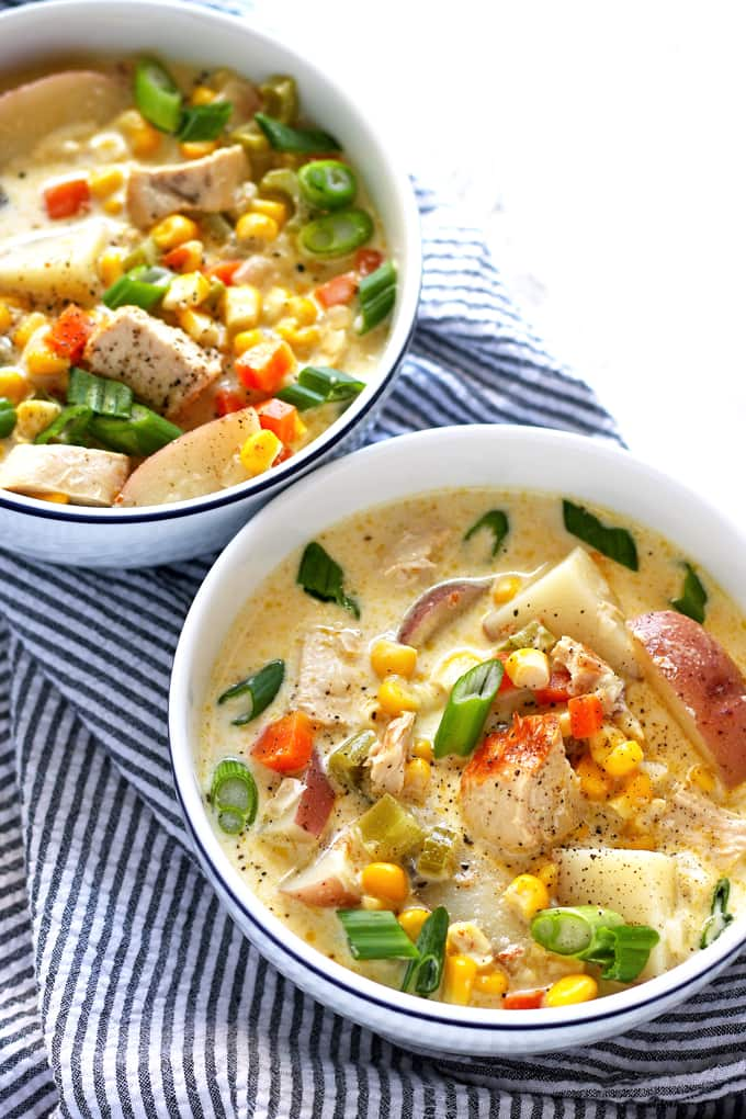 two bowls of chicken corn chowder