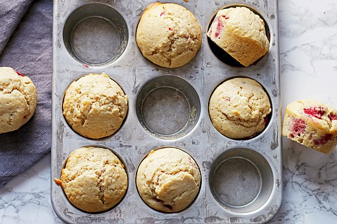 Muffin tin with raspberry lemon muffins