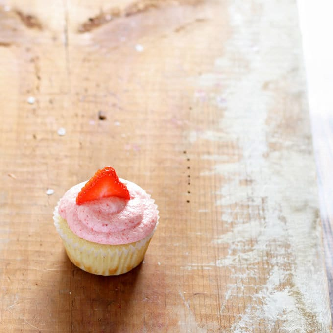 Strawberry lemonade cupcakes are the perfect spring dessert! Sweet and tangy - one of the BEST combinations out there!   honeyandbirch.com
