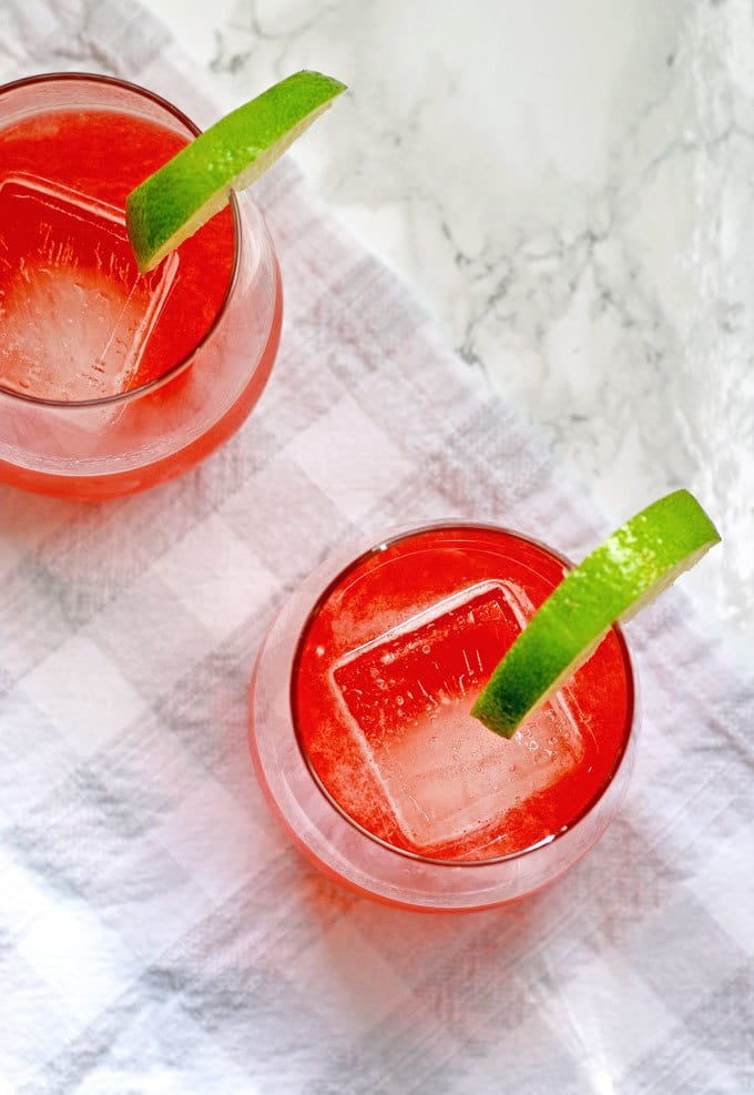 This strawberry rhubarb daiquiri recipe is the perfect spring cocktail! Plus, a recipe for homemade strawberry rhubarb simple syrup. | honeyandbirch.com
