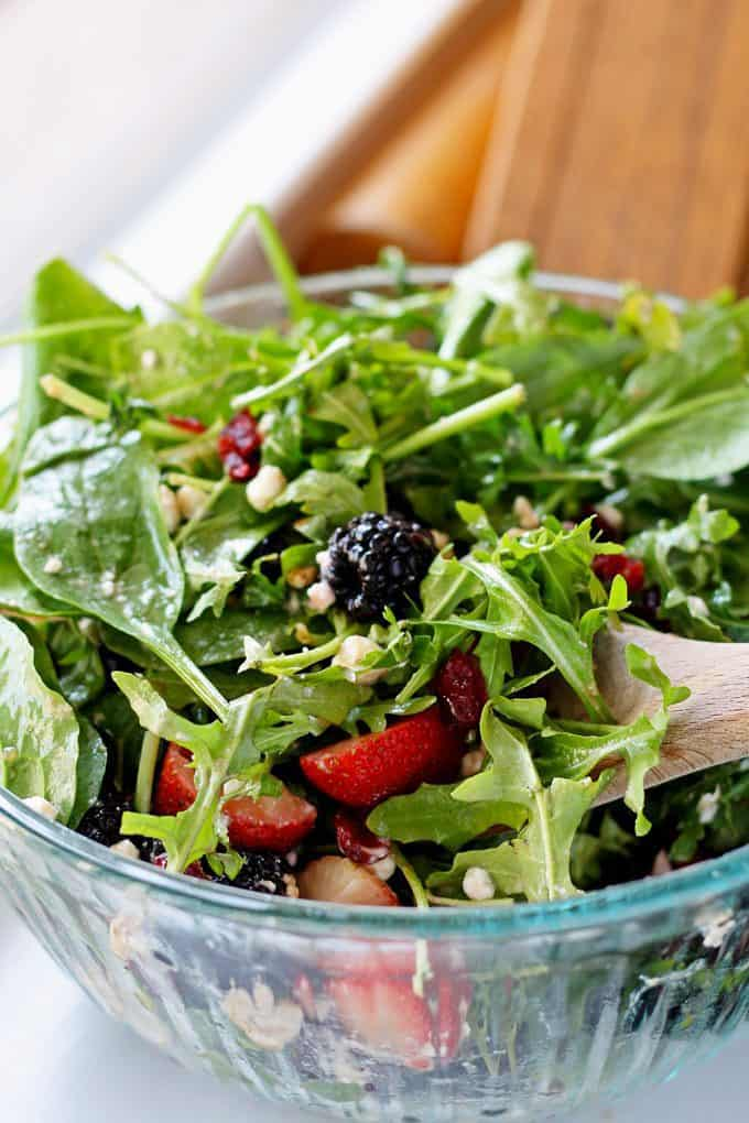 tossed berry goat cheese salad in glass bowl
