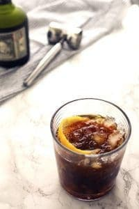 The black stripe cold rum cocktail is a fantastic drink with a surprise ingredient - molasses! If you are looking for something sweeter, add honey; if not, just enjoy the molasses and dark rum all on their own over crushed ice. | honeyandbirch.com