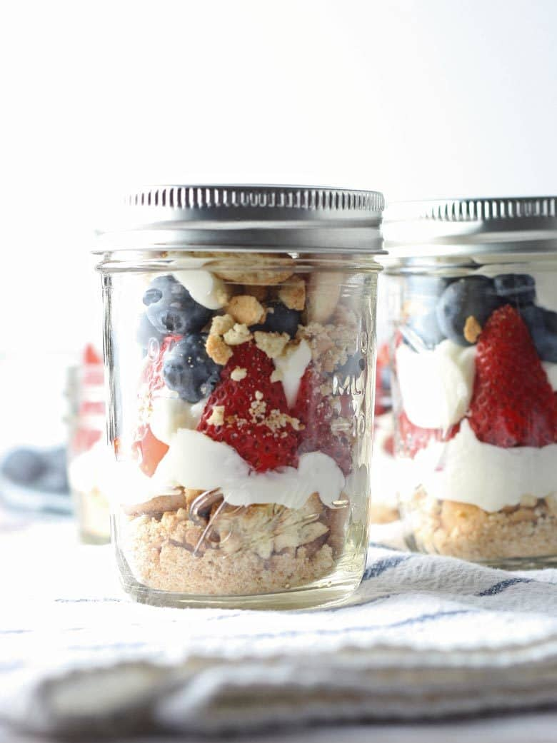 This red white and blue cheesecake parfait recipe is the perfect dessert for Memorial Day, Labor Day and Fourth of July parties! They are easy to make, full of fresh fruit and delicious!