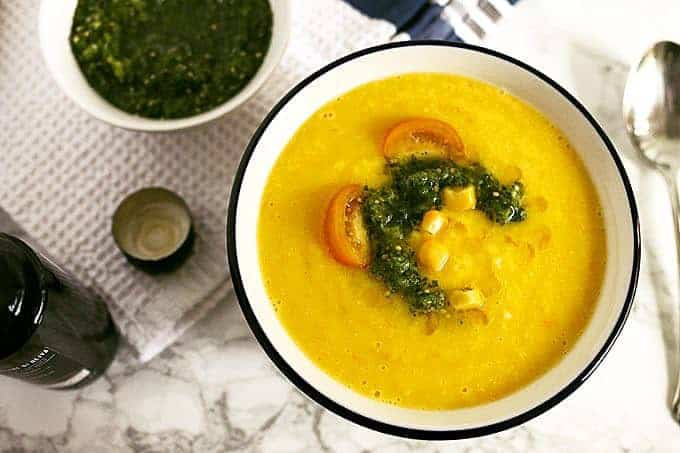 This sweet corn yellow tomato soup is a taste of pure summer and straight out of Heather Christo's book Pure Delicious. Top it with a dash of cilantro sauce and you're day will be made! | honeyandbirch.com