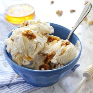 This no churn honey nut ice cream is easy to make and delicious on a hot summer day. Vanilla, almonds, walnuts and honey are perfect additions to 2-ingredient no churn ice cream! | honeyandbirch.com