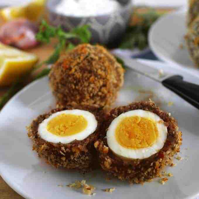 These baked scotch eggs are the perfect party appetizer! Serve them with my shallot yogurt dip; your guests will definitely come back for more! | honeyandbirch.com