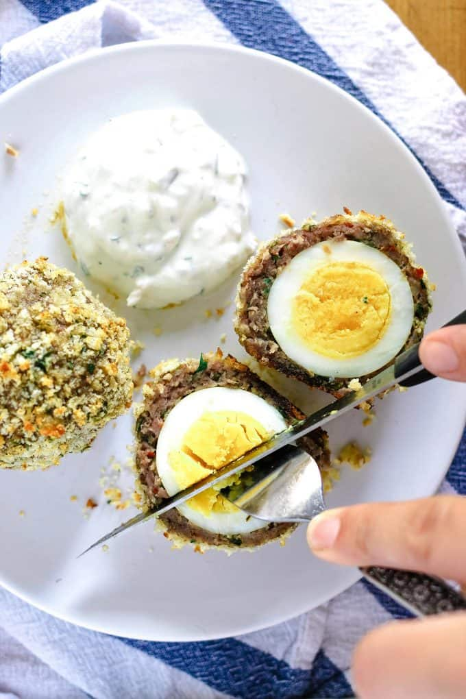 eating a baked scotch egg