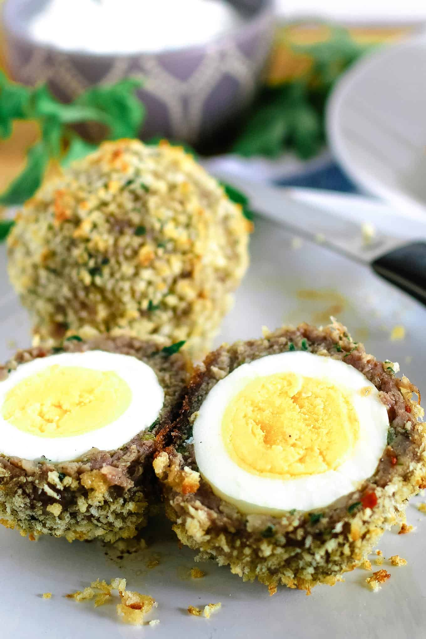 one baked scotch egg cut open