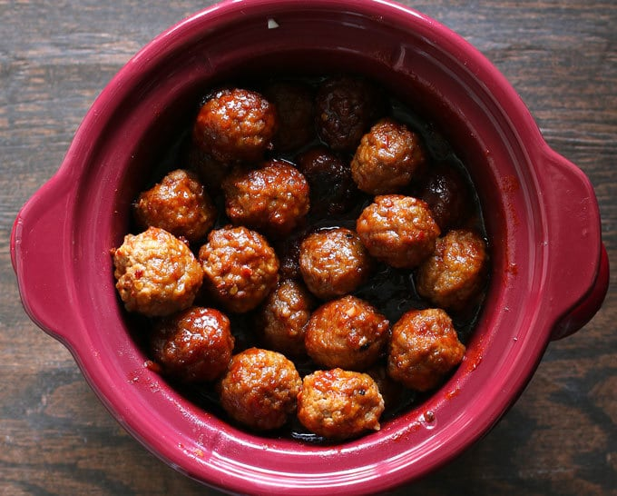 sweet and spicy meatballs in a crockpot