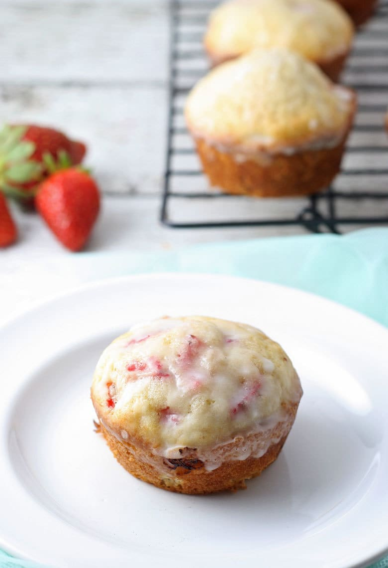 These strawberry muffins with glaze are easy to make - they're super moist, delicious and the strawberries will melt in your mouth! | honeyandbirch.com