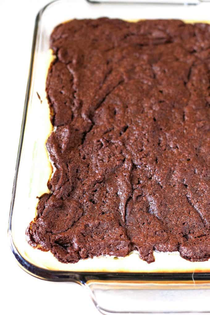 cooked cream cheese brownies in a glass baking dish