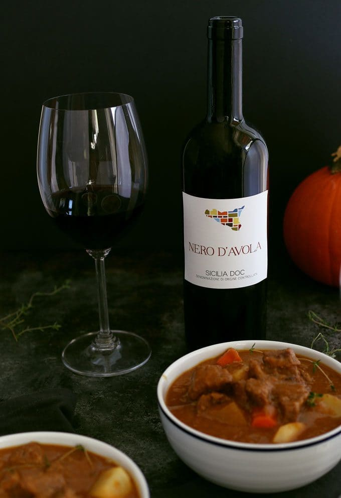 This pumpkin beef stew recipe is the perfect meal for cool autumn nights. It is savory, hearty and guaranteed to warm you up! Pair it with a glass of Nero d'Avola, one of my favorite Sicilian wines. | honeyandbirch.com