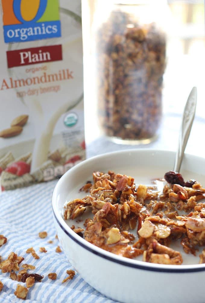 Apple cinnamon raisin granola is the perfect homemade snack or breakfast! It's super easy to make and delicious! | honeyandbirch.com AD