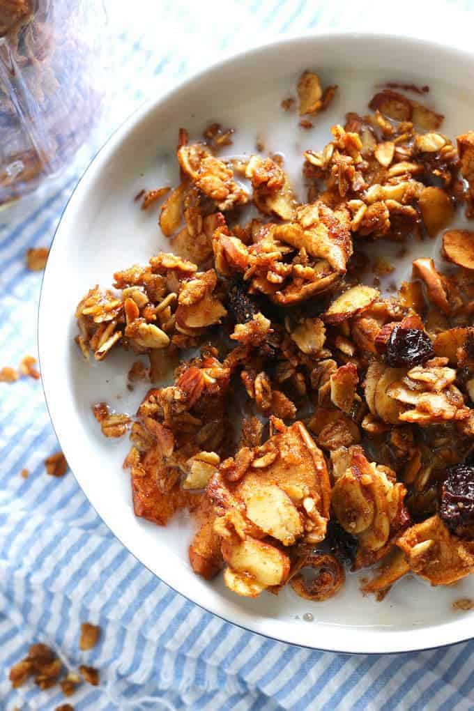 Apple cinnamon raisin granola is the perfect homemade snack or breakfast! It's super easy to make and delicious! | honeyandbirch.com