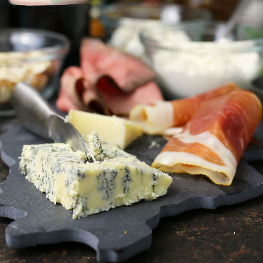 blue cheese and prosciutto on slate cutting board