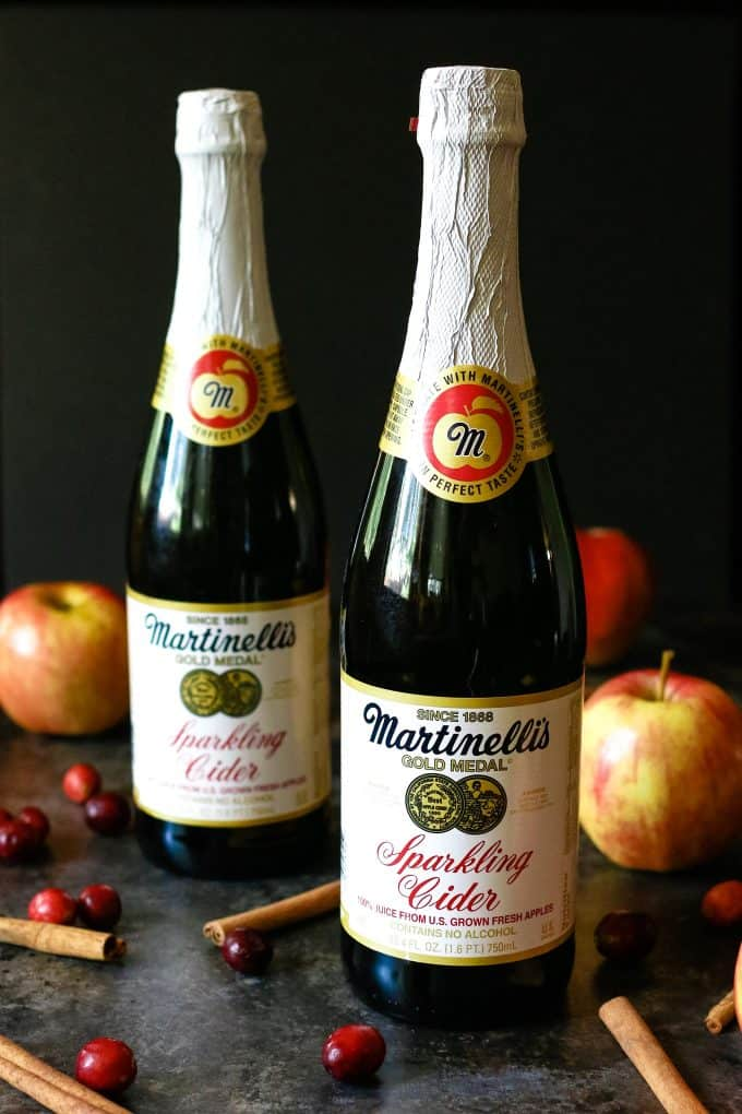 two bottles of sparkling apple cider