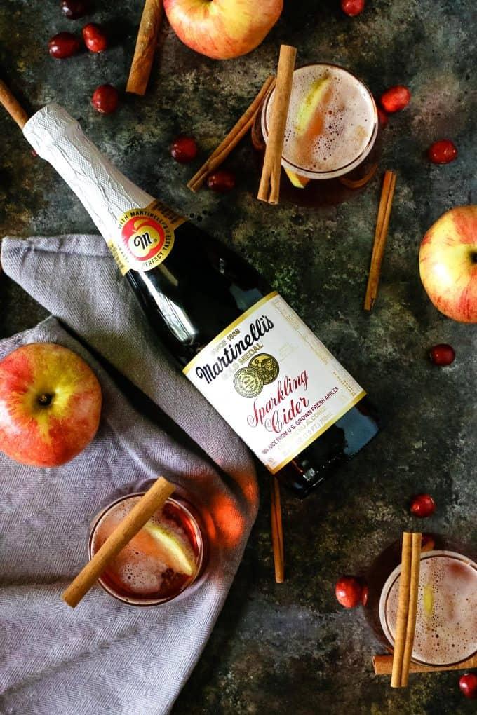 1 bottle of sparkling apple cider and several apple cider mimosas