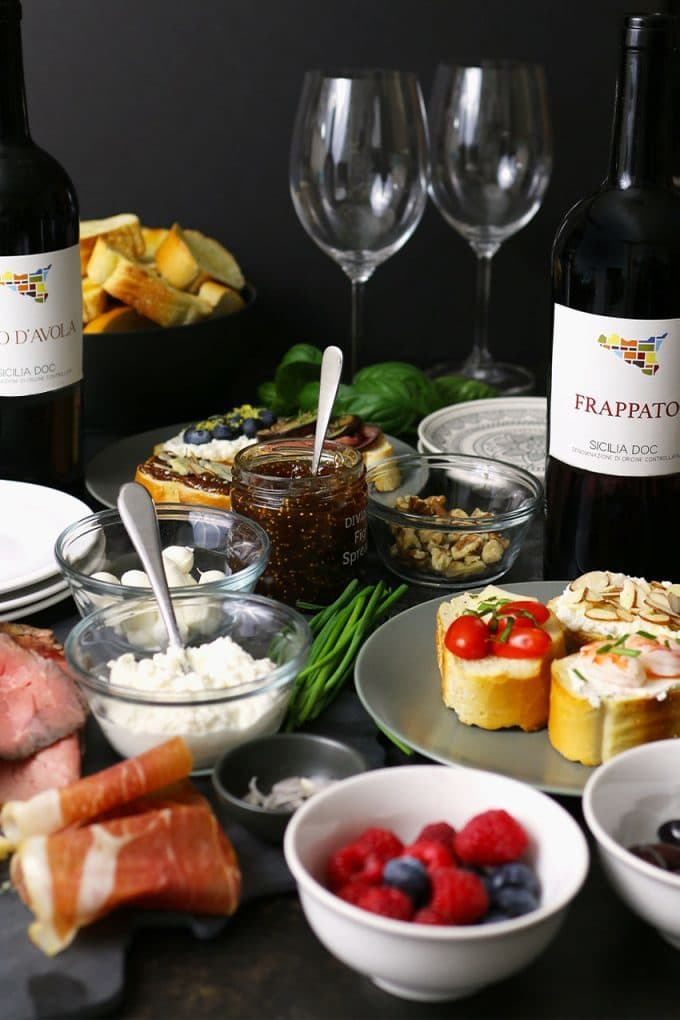 holiday crostini bar with bottle of frappato