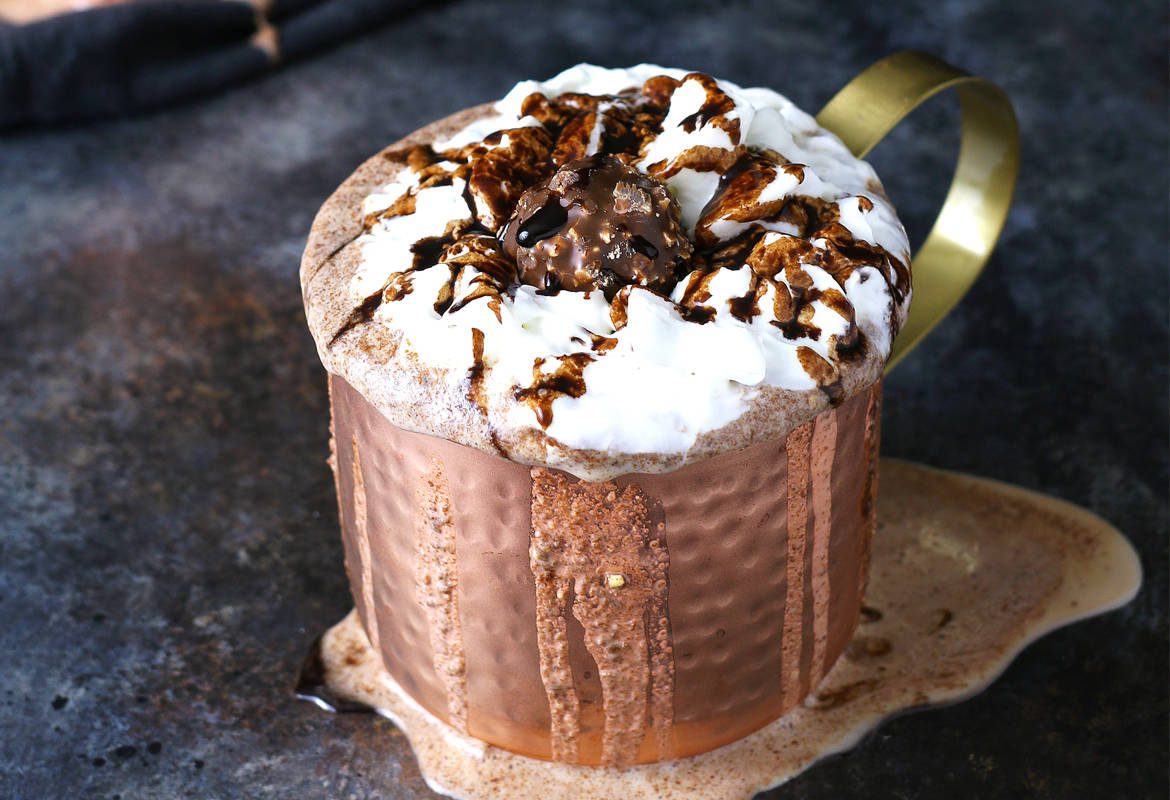 Nutella and Ferrero Rocher candies go so well together. That's why I combined them in this Nutella Ferrer Rocher milkshake. | honeyandbirch.com