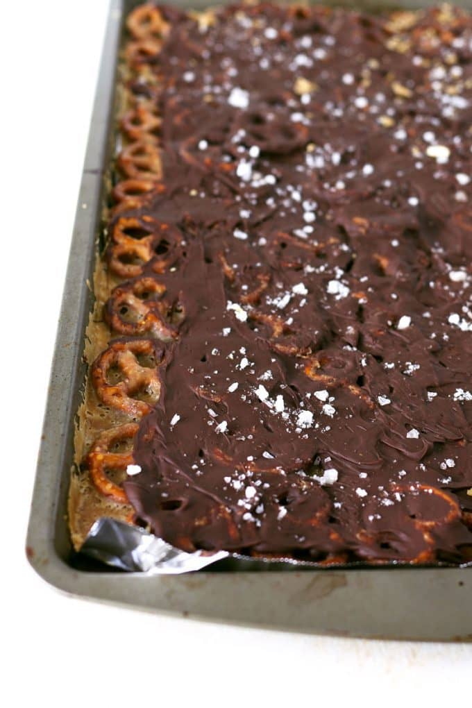 Salted caramel chocolate pretzel bark on a sheet pan