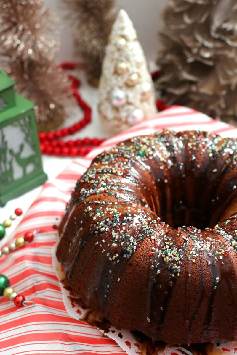 This six egg pound cake is flavored with hot cocoa and covered in chocolate and caramel syrups and sprinkles. Every holiday needs sprinkles.