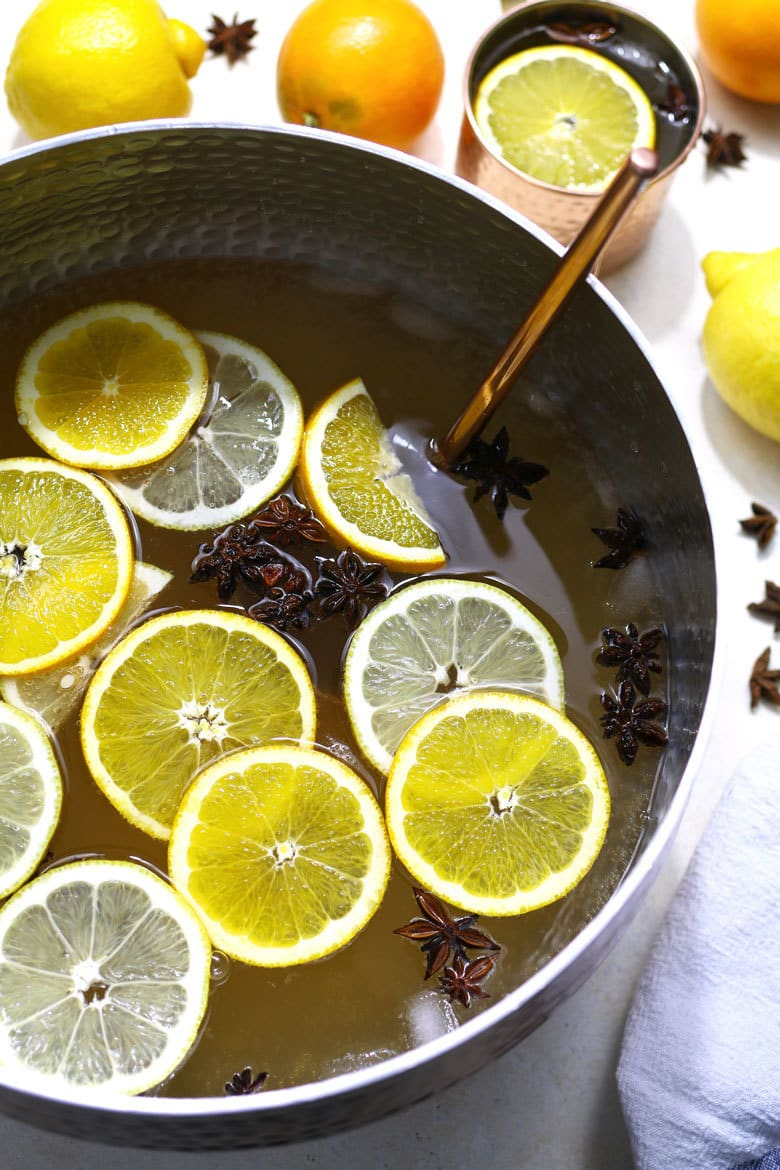 This ginger citrus punch recipe is VERY easy to make and it's perfect for all parties! Whether it's Christmas, New Year's Eve, weddings or a birthday party, this is going to be your new go-to big batch cocktail. | honeyandbirch.com