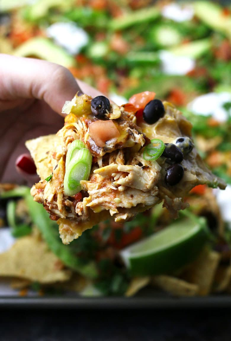 single portion of loaded chicken nachos