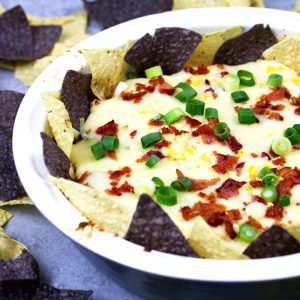If you like cheese dips, this chipotle bacon corn cheese dip recipe is going to make you so happy! Baked in the oven with three different types of cheese, it's creamy and delicious.