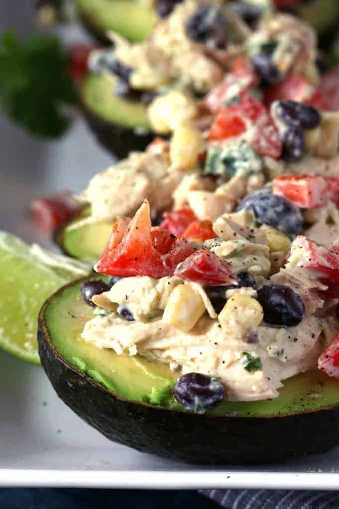 southwest chicken salad stuffed avocados on a plate