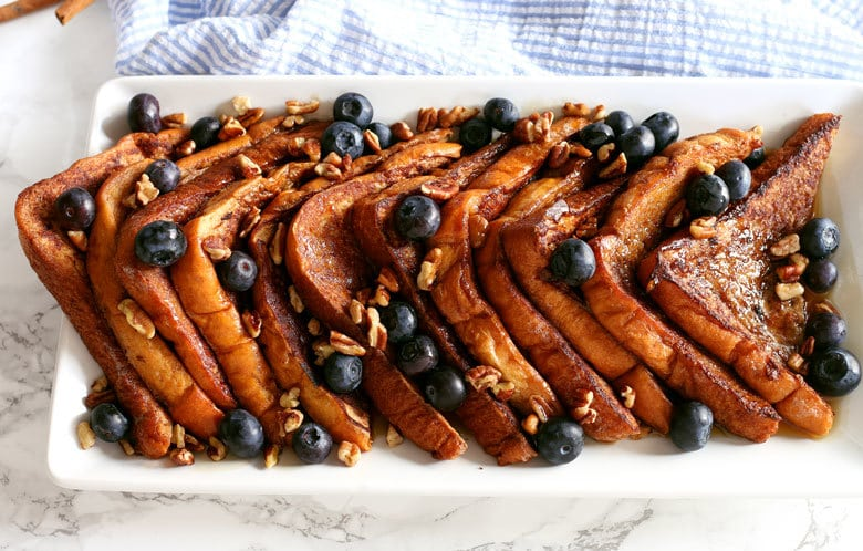 This cinnamon french toast is a great addition to your next brunch with simple ingredients. Top with fresh blueberries, pecans and maple syrup.