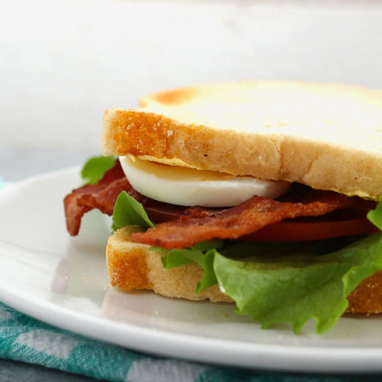 This deviled egg BLT sandwich is the perfect lunch. Make small-batch deviled eggs on demand with this recipe and enjoy your favorite sandwich at the same time! | honeyandbirch.com