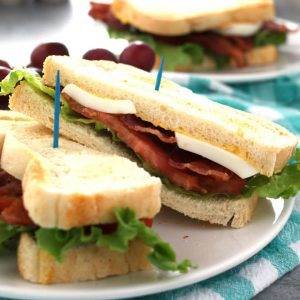 This deviled egg BLT sandwich is the perfect lunch. Make small-batch deviled eggs on demand with this recipe and enjoy your favorite sandwich at the same time!   honeyandbirch.com