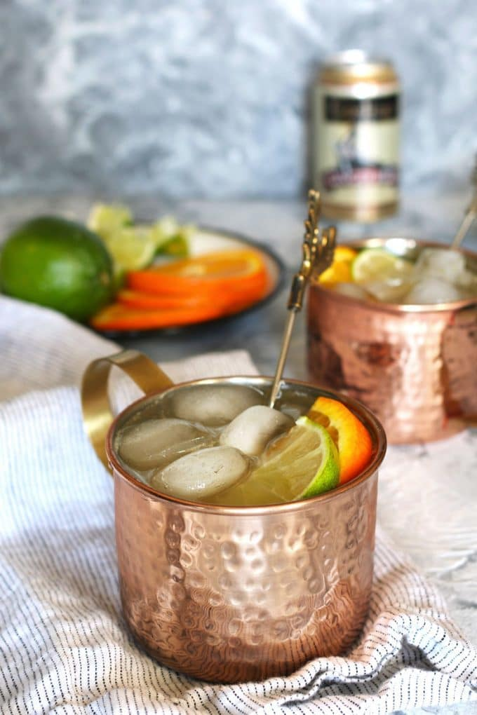 two orange Moscow mule cocktails