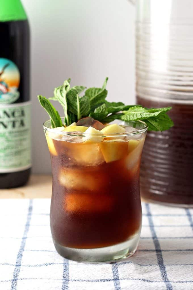 bottle of branca menta, one apple iced tea mint cocktail and pitcher of iced tea