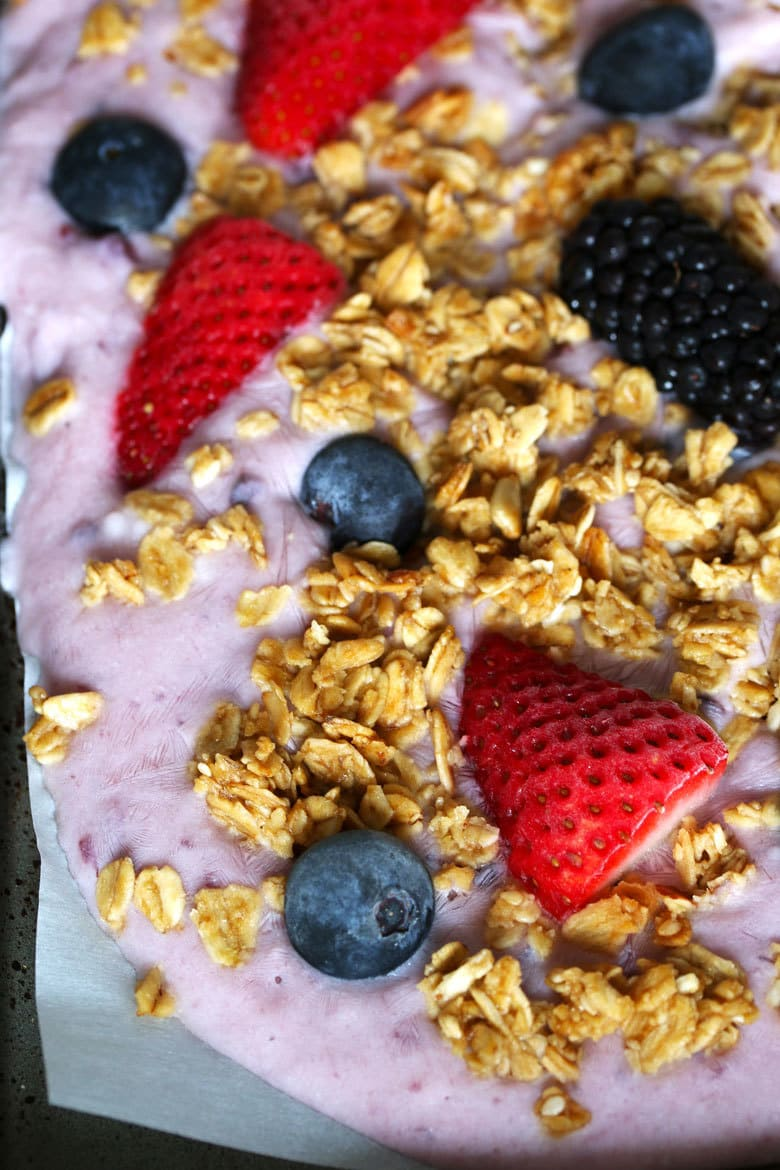 This triple berry granola frozen yogurt breakfast bark is perfect for busy mornings. It's like eating a make-ahead breakfast parfait popsicle and is great for feeding a crowd! Uncracked bark up close.