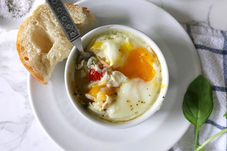 Caprese baked eggs only require 4 ingredients and a little salt and pepper. This easy recipe is going to become your go-to quick recipe for breakfast or brunch!