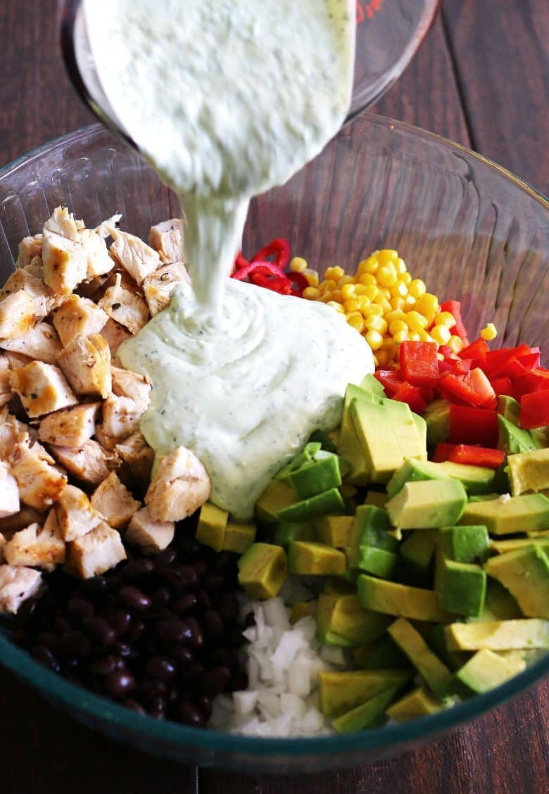 grilled chicken avocado salad topped with homemade jalapeno cilantro dressing