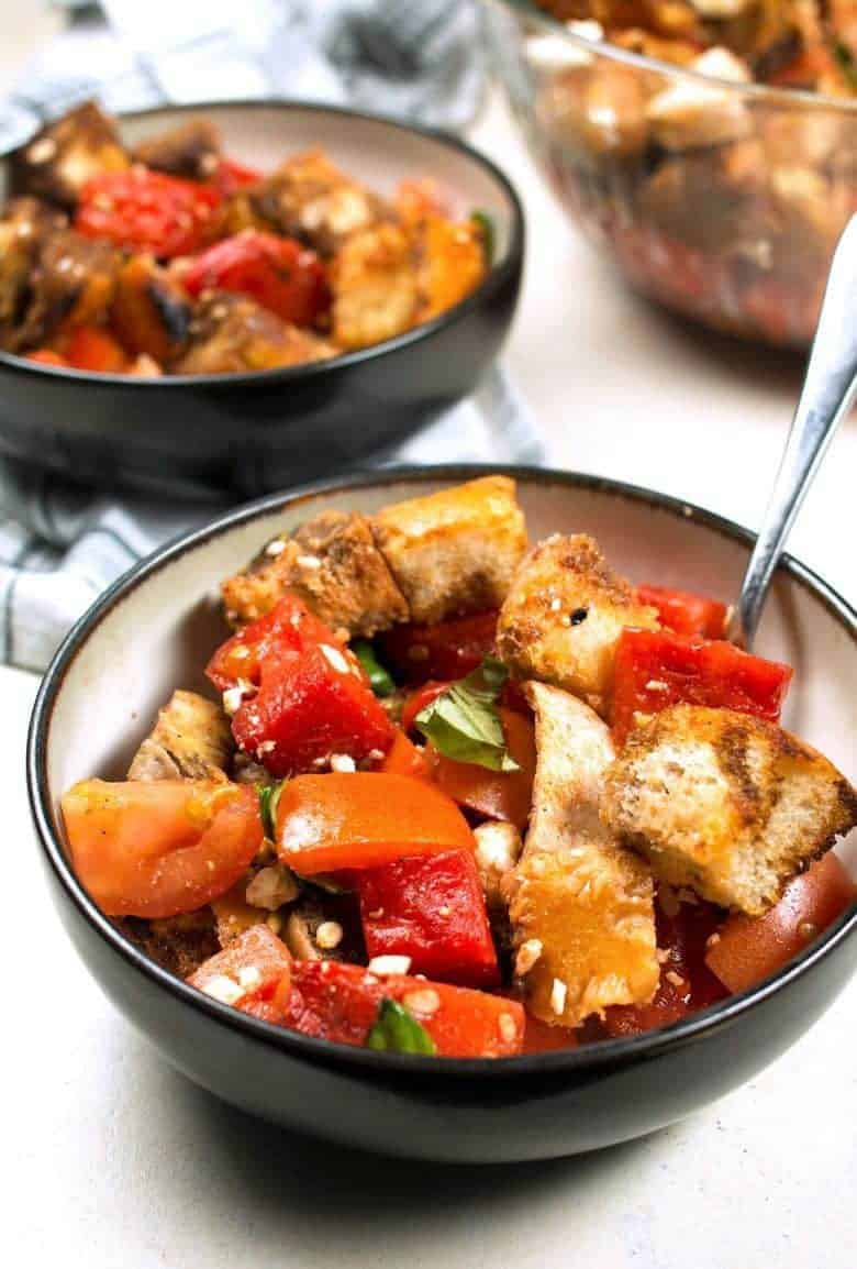 Grilled watermelon chicken panzanella salad is a great unique addition to any summer barbecue! It's easy to make and full of color and flavor.