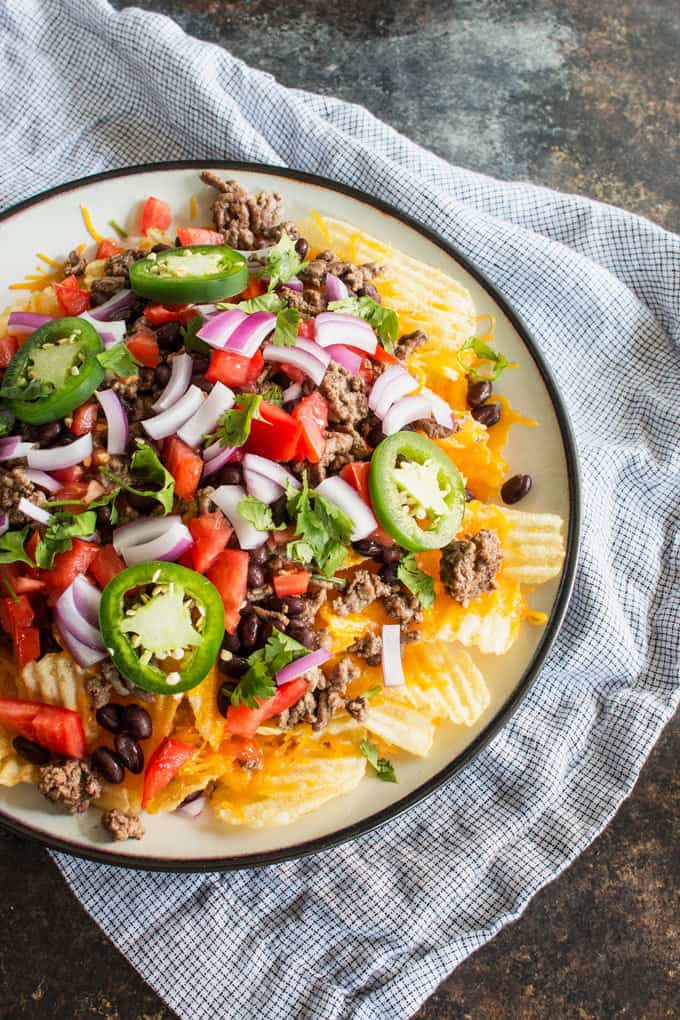 Last-minute tailgating party? Make these easy potato chip nachos with all of your favorite toppings! This is going to become your favorite game day food.