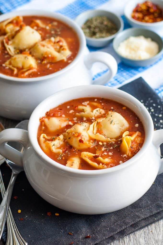 two bowls of tomato tortellini soup
