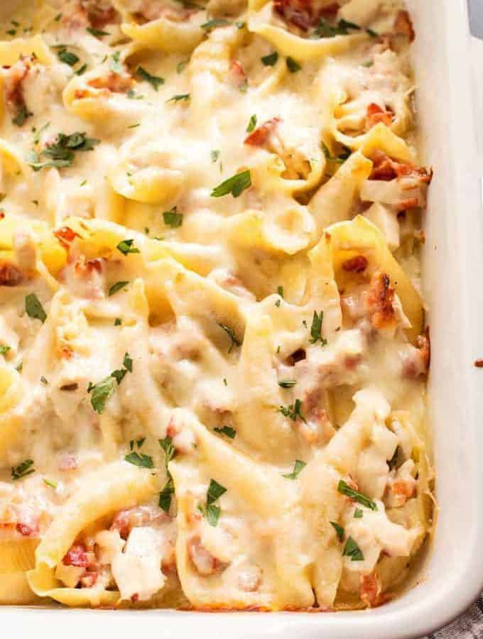These chicken bacon Alfredo stuffed shells are perfect for Sunday supper! Use store bought Alfredo sauce or homemade for an extra special touch.