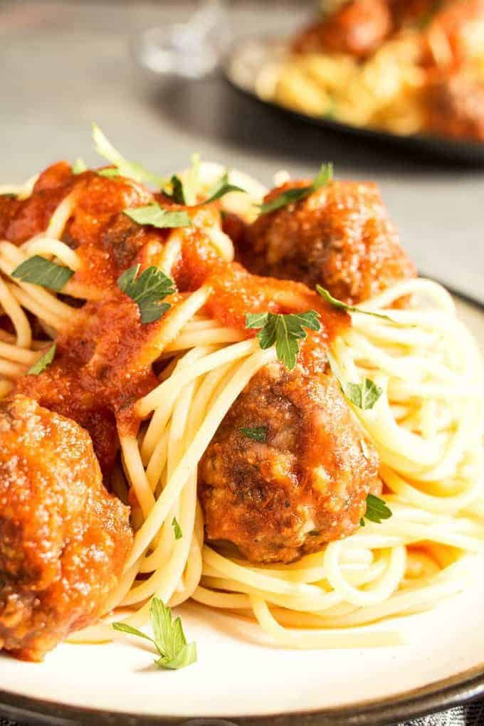 This easy homemade spaghetti and meatballs recipe is perfect for busy weeknights. Prep the meatballs the day before and then pop them in the oven when it's time for dinner!