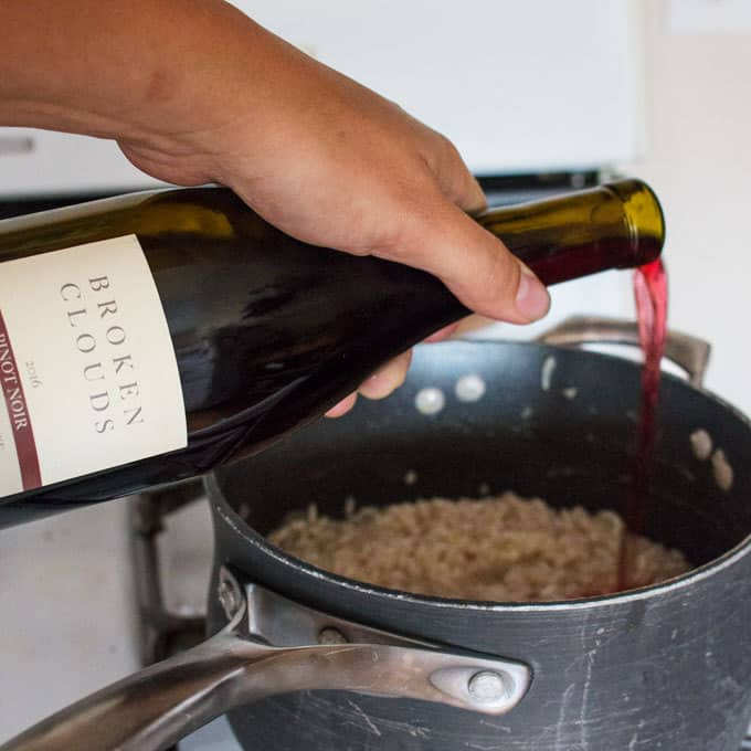 red wine being poured into pot