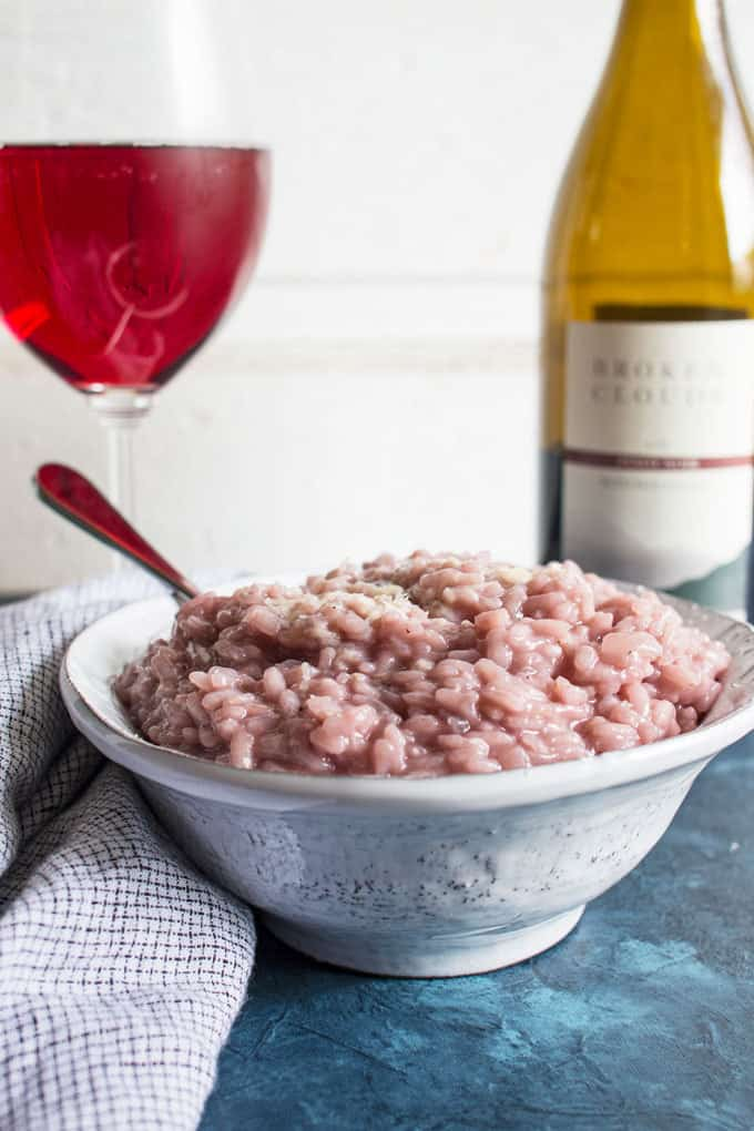 red wine risotto in a pottery bowl