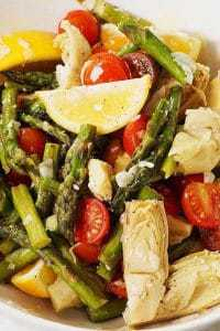 close up photo of asparagus and cherry tomato salad