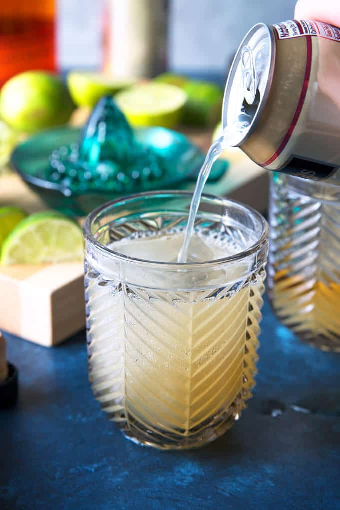 ginger beer being poured into a Kentucky Mule